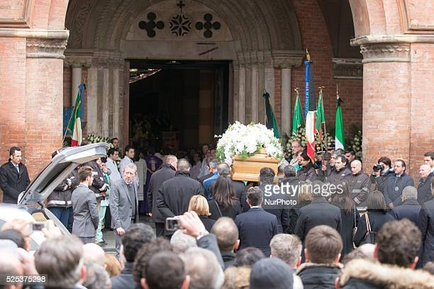 The coffin of Michele Ferrero carried by Ferrero workers enter from the church in the center of Alba on February 18 2015 in Alba northern Italy...