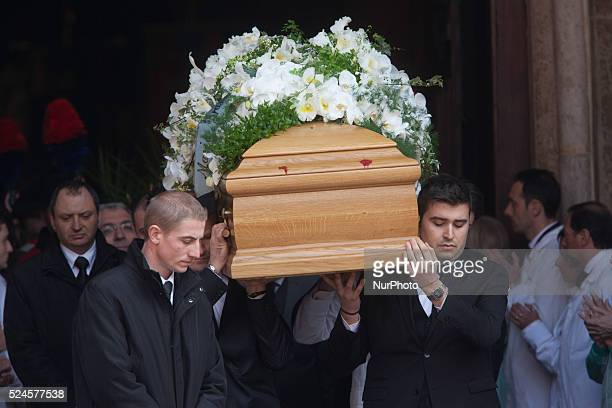 The coffin of Michele Ferrero carried by Ferrero workers exit from the church in the center of Alba on February 18 2015 Billionaire Michele Ferrero...