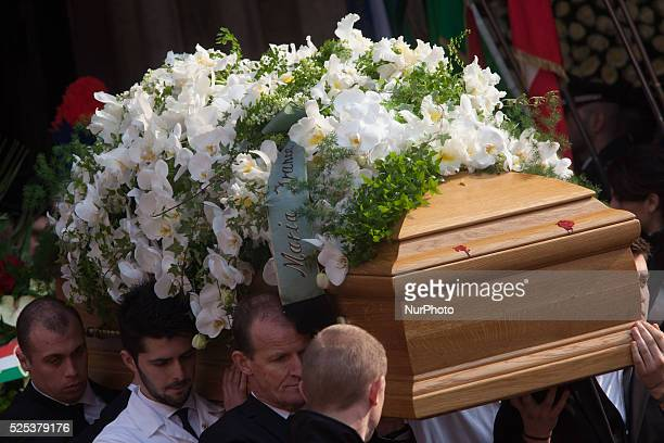 The coffin of Michele Ferrero carried by Ferrero workers exit from the church in the center of Alba on February 18 2015 in Alba northern Italy...