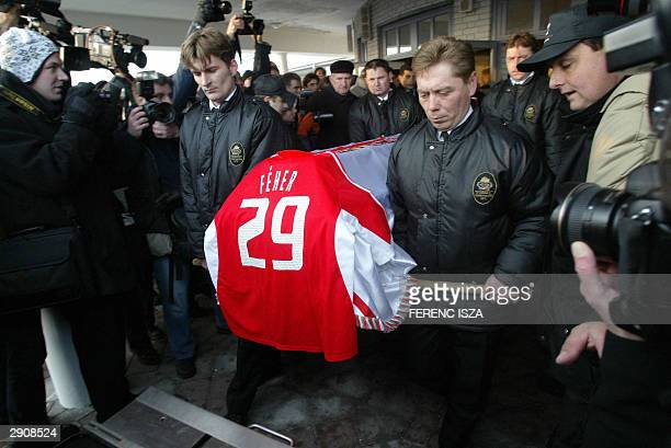 The coffin of Miklos Fehrer covered with Feher's jersey is carried during the funerals 28 January 2004 in Gyor 120 km east from Budapest Almost a...