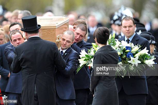 The coffin of Pc David Rathband is carried from Stafford Crematorium on March 17 2012 in Stafford England PC Rathband who was shot and blinded by...