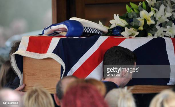 The coffin of Pc David Rathband is carried into Stafford Crematorium at his funeral on March 17 2012 in Stafford England PC Rathband who was shot and...