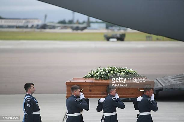 The coffin of Philip Heathcote is taken from the RAF C17 aircraft after it landed at RAF Brize Norton carrying nine of the victims of last Friday's...