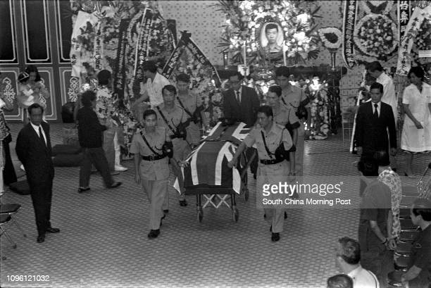 The coffin of police constable So Yiyi is covered with a British flag at his funeral So was killed in a traffic accident while on duty in Happy...