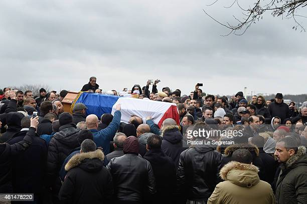 The coffin of policie officer Ahmed Merabet, draped in the French flag, is carried during a funeral at a muslim cemetary on January 13, 2015 in...