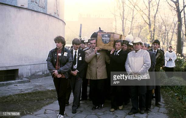 The coffin of Polish priest Jerzy Popieluszko is carried to the Saint Stanislaw Kostka church during his funeral on November 03 1984 in Warsaw...