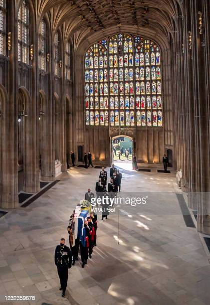 The coffin of Prince Philip, Duke of Edinburgh, accompanied by members of the Royal family, is carried by pall bearers into his funeral service at St...