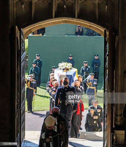 The coffin of Prince Philip, Duke of Edinburgh, is carried into his funeral service at St George's Chapel at Windsor Castle on April 17, 2021 in...