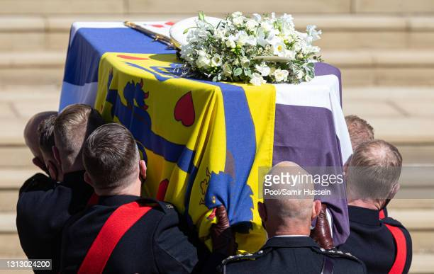 The coffin of Prince Philip, Duke of Edinburgh is carried into St George's Chapel during the funeral of Prince Philip, Duke of Edinburgh on April 17,...