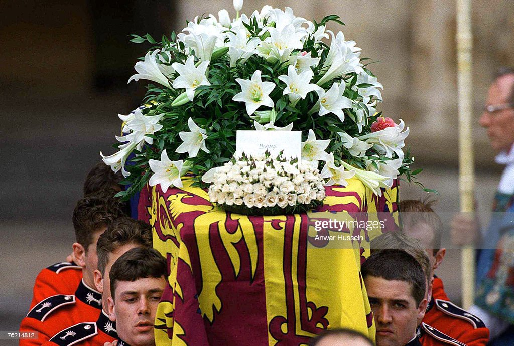 The coffin of Princess Diana, Princess of Wales, leaves Westminster Abbey after the funeral service on September 6, 1997. The touching flral tribute from her sons says simply 'Mummy'.
