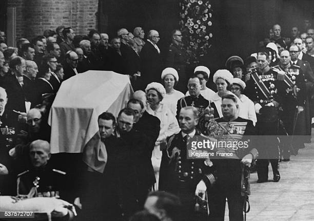 The coffin of Princess Wilhelmina comes inside Delft cathedral in the presence of Queen Juliana Prince Bernhard and Princesses Beatrix Margriet Irene...