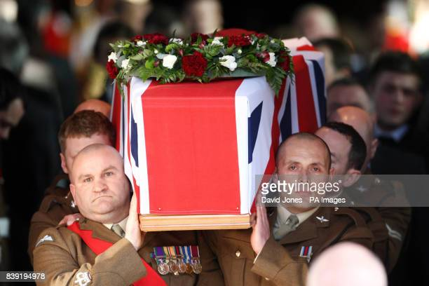 The coffin of Private Conrad Lewis is carried from The Collegiate Church of St Mary in Warwick after his funeral service today