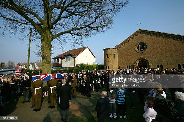 The coffin of Sapper Mark Quinsey is carried by his comrades out of Immanuel Church in Highters Heath after his funeral service on March 18 2009 in...