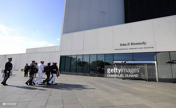 The coffin of Senator Edward Kennedy is carried by a honour guard at the entrance of the John F Kennedy Presidential Library and Museum where his...