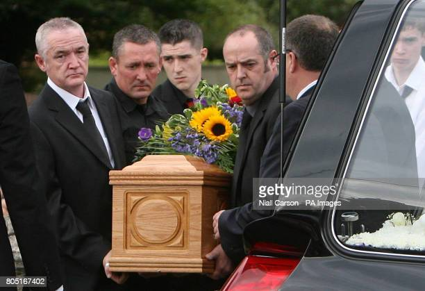 The coffin of Shane Clancy is carried by relatives from the Church of the Assumption in Dalkey Co Dublin following his funeral mass.