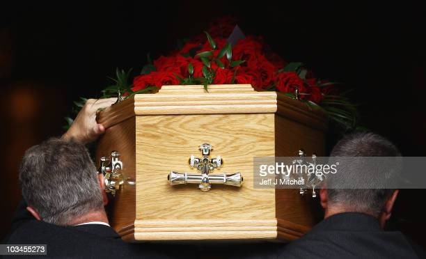 The coffin of shipyard and trade union icon Jimmy Reid enters Govan Old Parish Church on August 19, 2010 in Glasgow, Scotland. Hundreds of mourners...