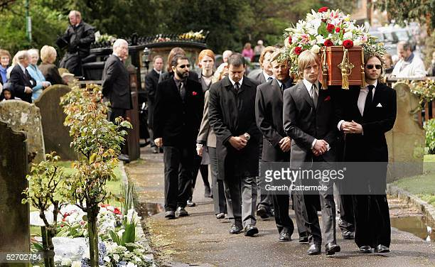 The coffin of Sir John Mills is carried into The Parish Curch of Saint Mary the Virgin on April 27 2005 in Denham