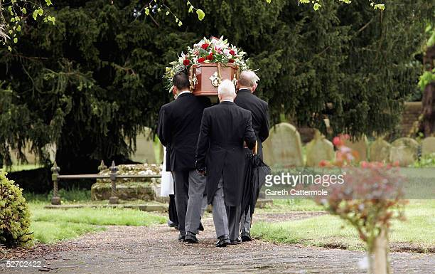 The coffin of Sir John Mills is carried through the grounds of The Parish Church of Saint Mary the Virgin on April 27 2005 in Denham Buckinghamshire