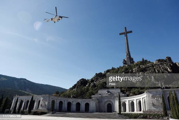 The coffin of Spanish dictator Francisco Franco is carried in a Super Puma helicopter as it is transported to the Mingorrubio El Pardo cemetery after...