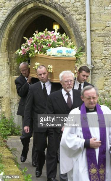 The coffin of television reporter Terry Lloyd who died while covering the war in Iraq is carried from St Nicholas Church Cuddington Buckinghamshire...