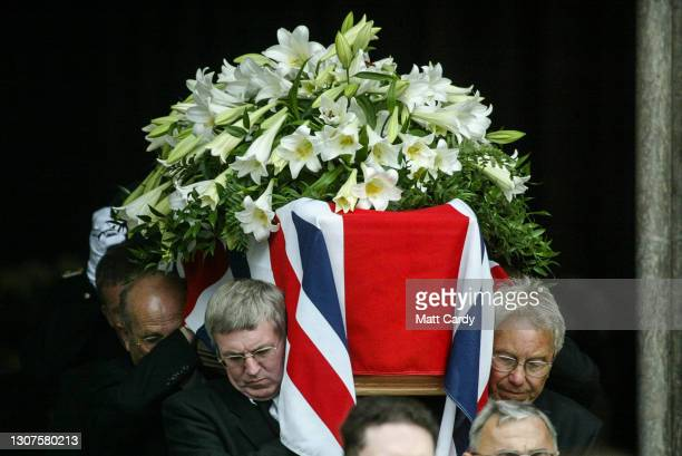 The coffin of the former Conservative prime minister Sir Edward Heath is carried by pall bearers from Salisbury Cathedral on July 25, 2005 in...