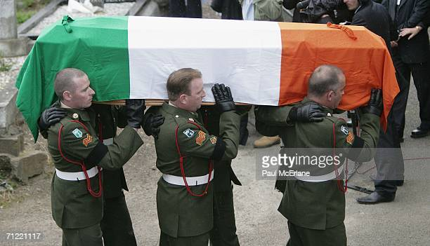 The coffin of the former Irish Prime Minister Charles Haughey arrives for the burial service in St Fintan's Cemetery on June 16 2006 in Sutton Dublin...
