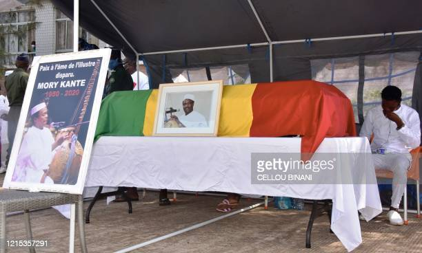 The coffin of the late Guinean singer Mory Kante is displayed during his funeral on May 26 2020 in Conakry Guinea Hundreds of people gathered to...