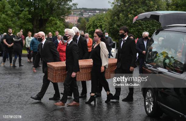 The coffin of the late John Humes is carried into St Eugene's Cathedral on August 4, 2020 in Londonderry, Northern Ireland. The former SDLP leader...