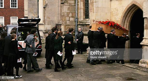 The coffin of the late radio presenter John Peel who died in Peru aged 65 is carried into St Edmundsbury Cathedral on October 26 at St Edmundsbury...