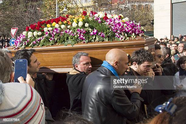 The coffin of the singer Mango goes in the church on the shoulders of his son Filippo for the funeral on December 10 2014 in Lagonegro Italy