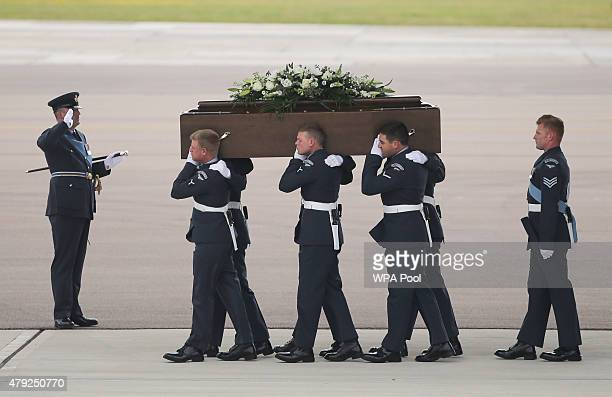 The coffin of Trudy Jones is taken from the RAF C17 aircraft after it landed at RAF Brize Norton carrying nine of the victims of last Friday's...