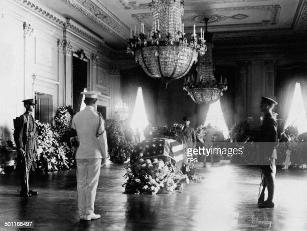 The coffin of US President Warren G Harding in the East Room of the White House, before his state funeral, Washington DC, August 1923.