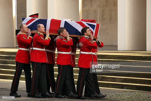 The coffin of Warrant Officer Class One Regimental Sergeant Major Darren Chant of the Genadier Guards is carried into the Guards Chapel on the...