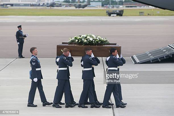 The coffin of William Graham is taken from the RAF C17 aircraft after it landed at RAF Brize Norton carrying nine of the victims of last Friday's...