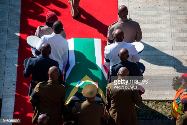 The coffin of Winnie Madikizela-Mandela is carried upon arrival at Orlando Stadium in Soweto on April 14, 2018. South Africa will lay to rest...