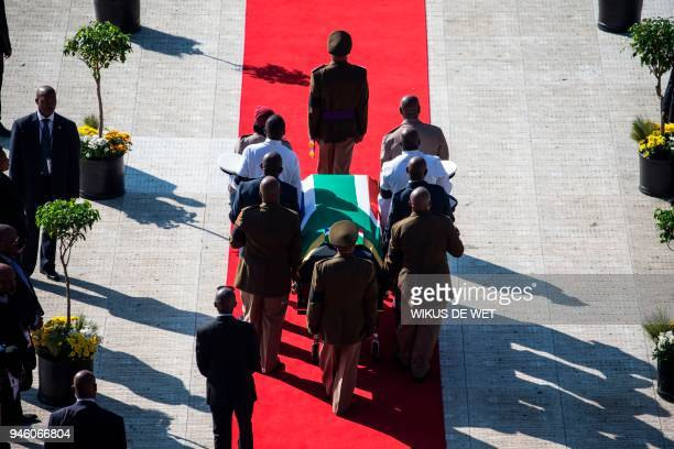The coffin of Winnie Madikizela-Mandela is carried upon arrival for a funeral ceremony at Orlando Stadium in Soweto on April 14, 2018. South Africa...