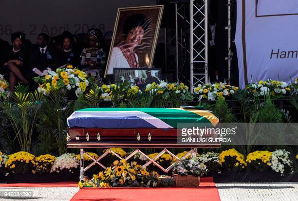 TOPSHOT The coffin of Winnie MadikizelaMandela is displayed in front of the stage at Orlando Stadium for the funeral ceremony in Soweto South Africa...