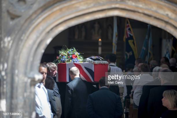 The coffin of World War 2 veteran Patrick Churchill is carried into St Mary The Virgin Church in Witney on July 18 2018 in Oxfordshire England...