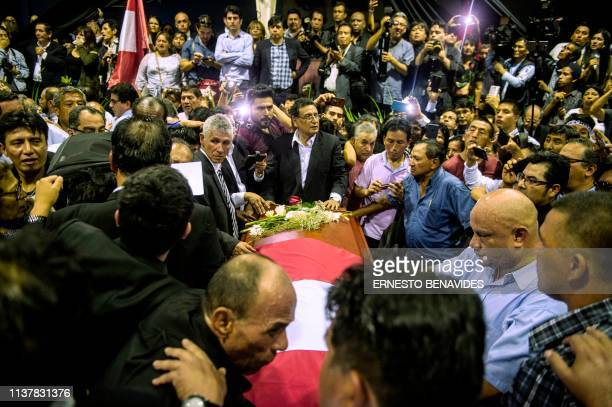 The coffin with the remains of late Peruvian former President Alan Garcia arrives to the American Popular Revolutionary Alliance party headquarter's...
