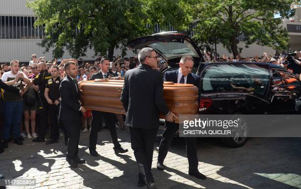 The coffin with the remains of Spanish football player Jose Antonio Reyes arrives for the wake at the Ramon Sanchez Pizjuan stadium in Seville on...