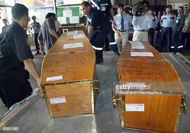 The coffins containing the remains of Japanese veteran warcorrespondent Shinsuke Hashida and freelance journalist Kotaro Ogawa are seen during their...