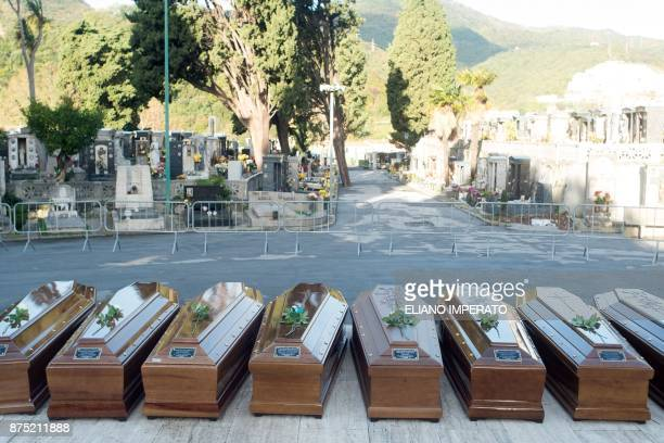 The coffins of 26 teenage migrant girls found dead in the Mediterranean in early November are pictured in the cemetery of Salerno southern Italy...