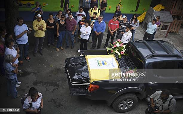 The coffins of 9yearold Marielos Sanches and his brother 12yearold Heison Sanchez victims of October 1st landslide remain in a pickup during a...
