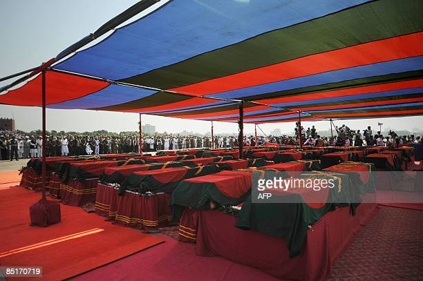 The coffins of Bangladeshi military officers killed during a mutiny are seen during a funeral ceremony attended by military officials and civilians...
