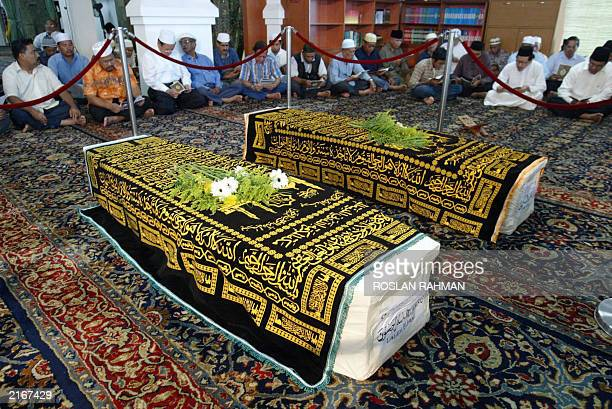 The coffins of Iranian twins Ladan and Laleh Bijani are laid on the hall of Ba'Alwi Mosque in Singapore 09 July 2003 The bodies of Ladan and Laleh...