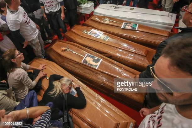 The coffins of some people who died in the tragedy of Casteldaccia during the funeral of the nine victims of the flood occurred in Palermo In a...