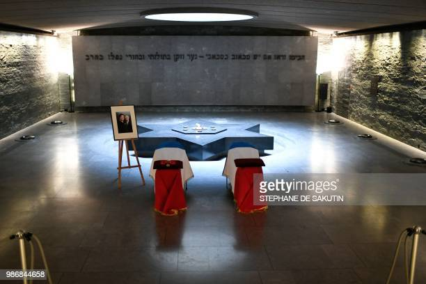 The coffins of women's rights icon French politician and Holocaust survivor Simone and her husband Antoine Veil are drapped in the French national...