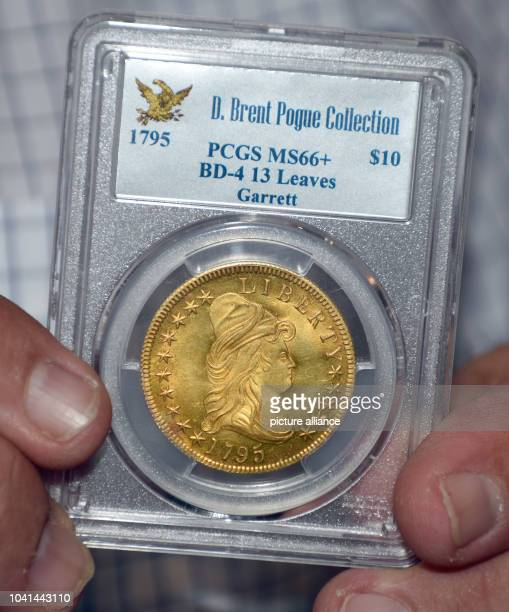The coin dealer Lawrence Stack presents a so called 'Bass Dannreuther' gold dollar from 1795 in New York USA The coin was estimated at 12 million...