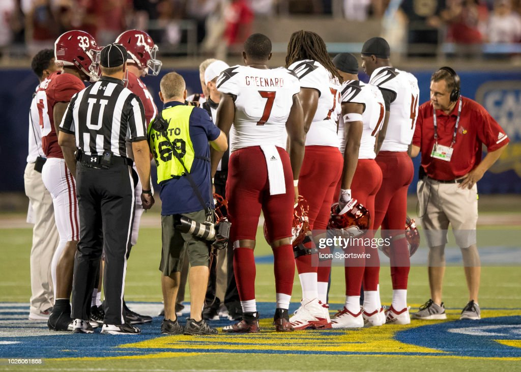 The Coin Toss During The Football Game Between The Alabama Crimson