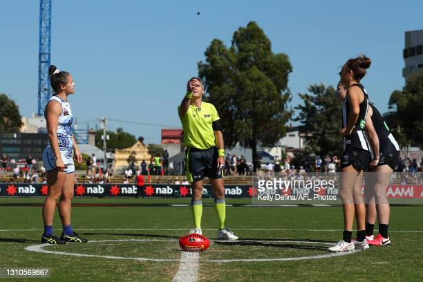 The coin toss is seen during the AFLW Finals Series match between the Collingwood Magpies and the North Melbourne Kangaroos at Victoria Park on April...